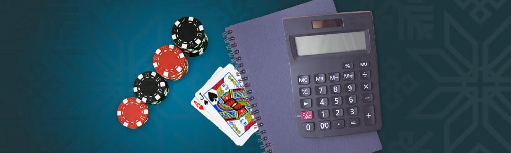 Pelimerkkejä, pelikortit, vihko ja laskin casinolla