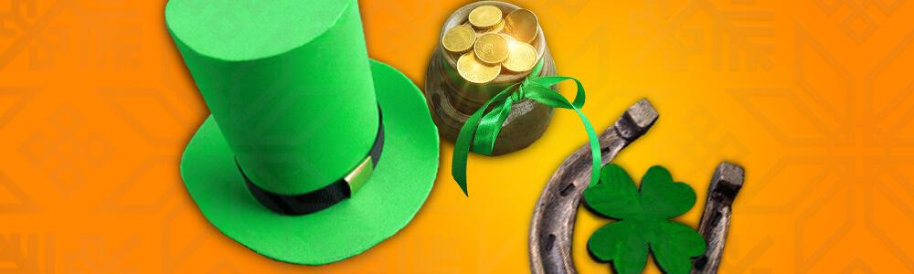Vihreä hattu, kolikoita ruukussa, hevosenkenkä ja neliapila