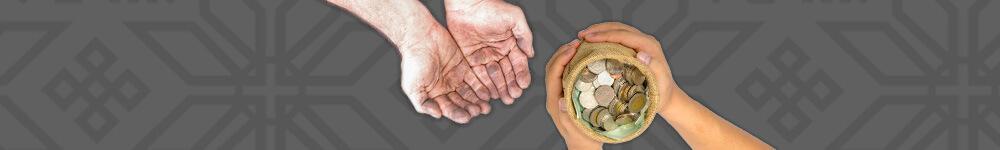 Joku pitelee rahasakkiä ja toinen ojentaa kätensä ottaakseen rahaa vastaan