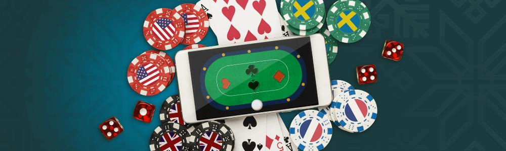 Kännykkä, pelikortteja, pelimerkkejä ja noppia